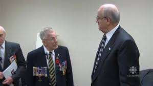 VAC Minister Julian Fantino (right) doing what he does best: treating a veteran like shit.